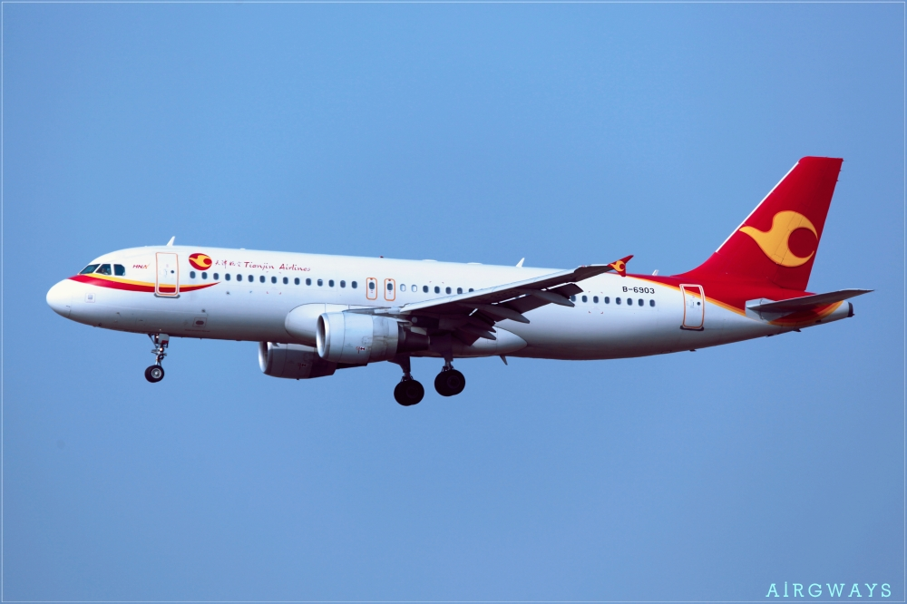 B-6903_-_Tianjin_Airlines_-_Airbus_A320-214_-_TAO_(16556349309)